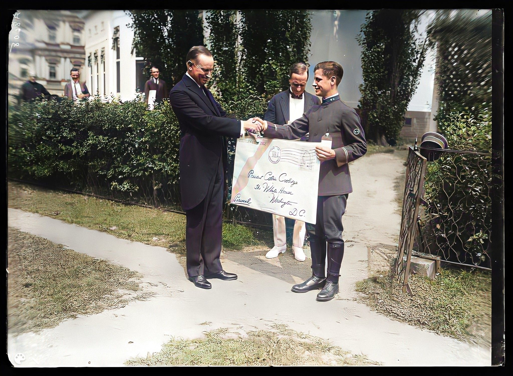 """President Coolidge receives a giant envelope with """"birthday greetings from 20,000 Mass citizens"""" from Louis Demontreux, Honor. Messenger of the Western Union from Boston, July 4, 1924. Courtesy of the Library of Congress"""