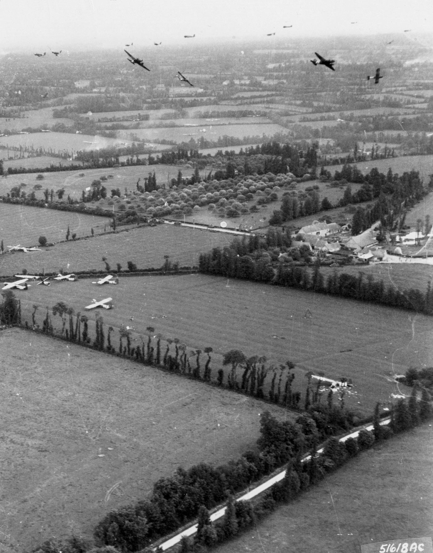Gliders are delivered to the Cotentin Peninsula by Douglas C-47 Skytrains