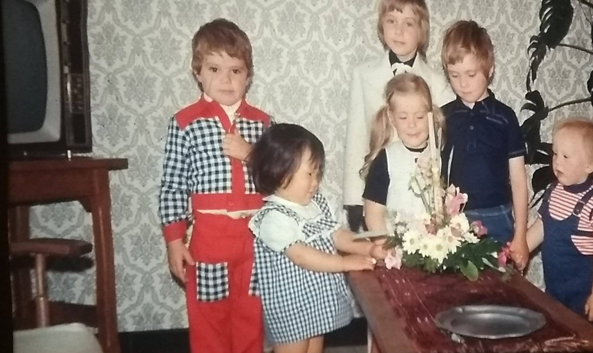 Kim as a child in Belgium with her adoptive family