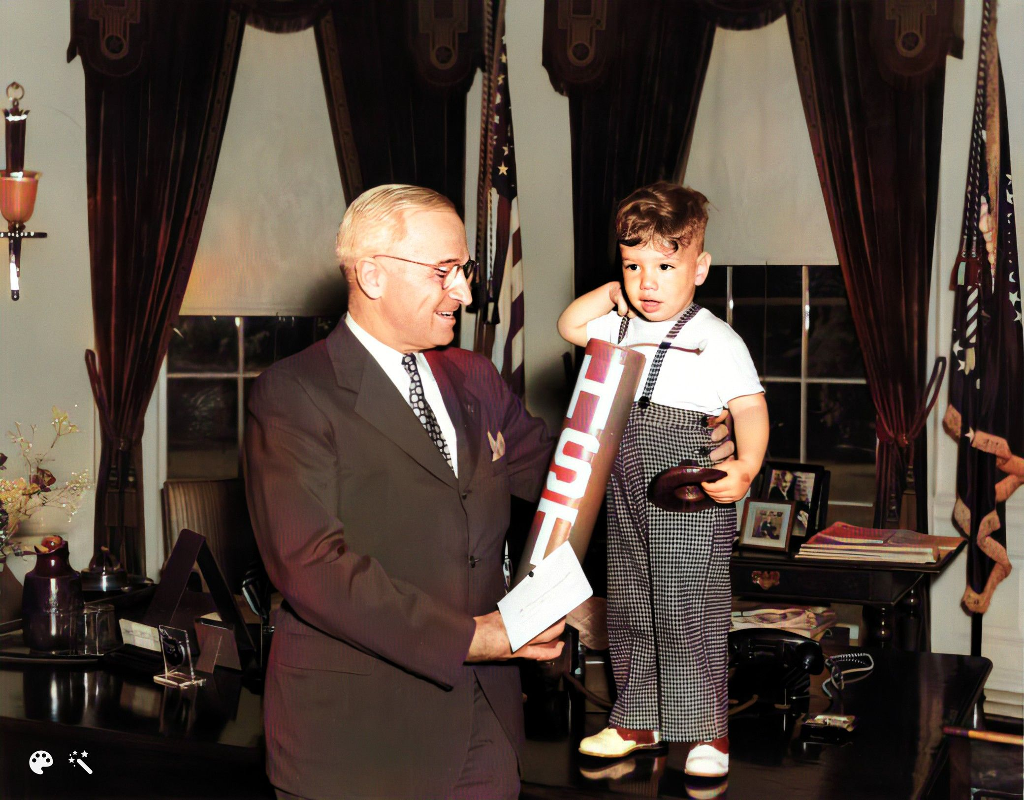 President Harry S. Truman receives the gift of a firecracker from a young boy in the Oval Office of the White House, July 4, 1947. Courtesy of the Library of Congress