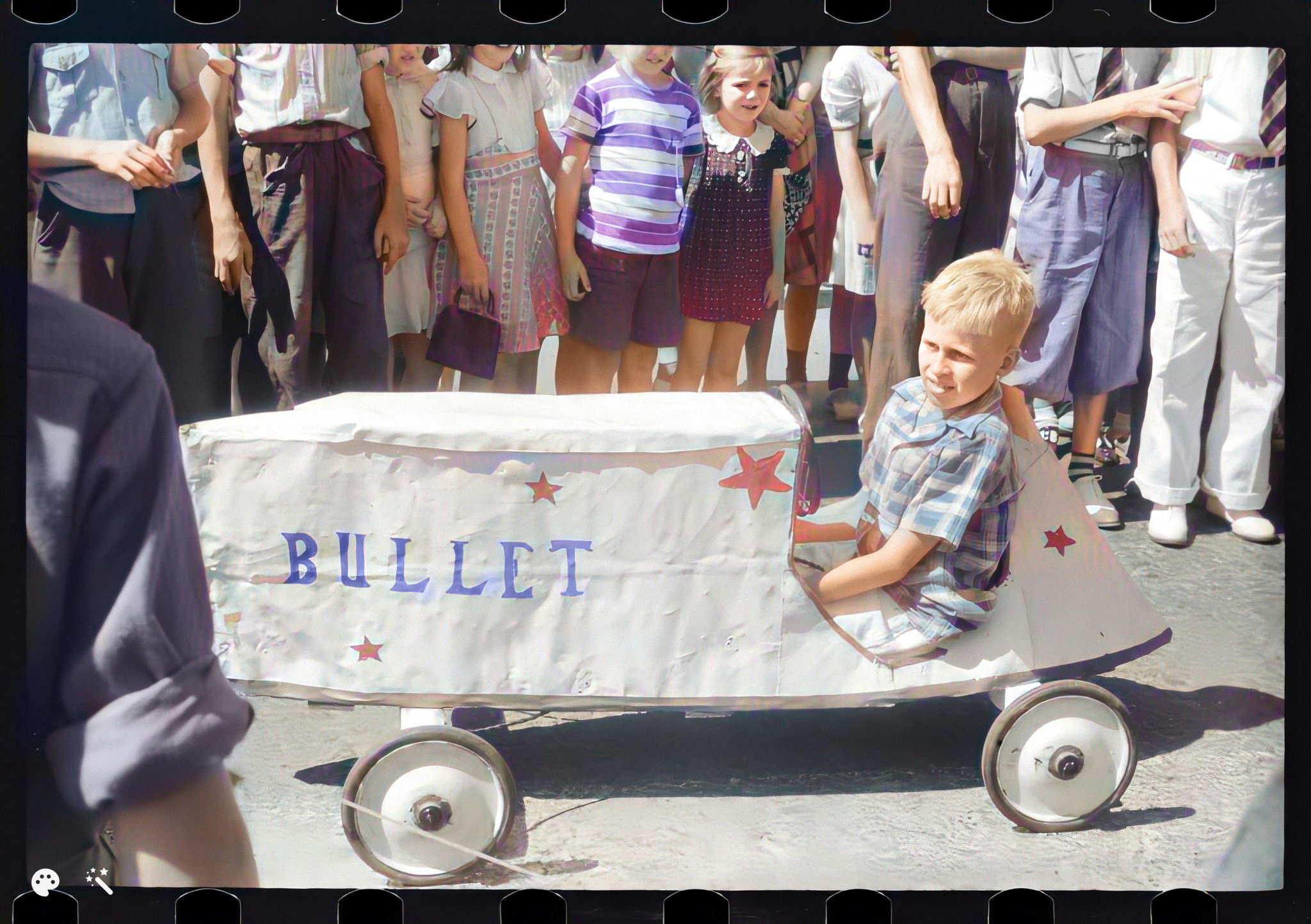 A little boy participates in a soapbox auto race with his vehicle, 'Bullet,' in Salisbury, Maryland, during the July 4 celebrations in 1940. Courtesy of the Library of Congress
