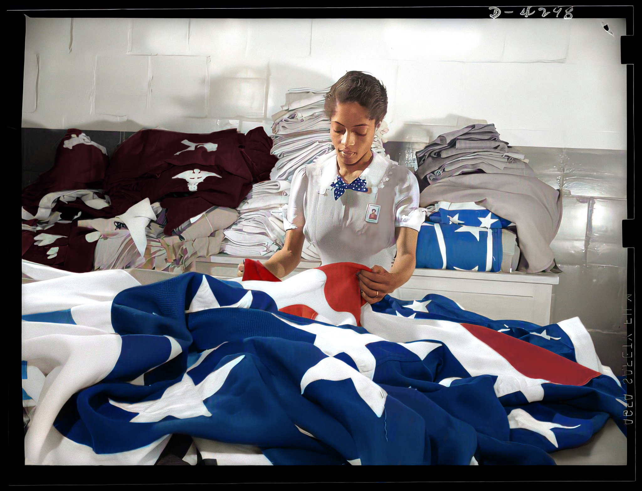 Woman worker creates American flags for military activities in the Philadelphia Quartermaster Corps depot, May 1942. Courtesy of the Library of Congress