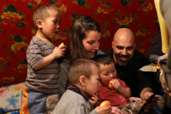 MyHeritage team members Shahar and Golan sharing a moment with Nenets children in Siberia.